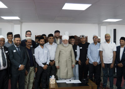 Group picture during the new converts mulakat with Huzoor (may Allah be His helper)